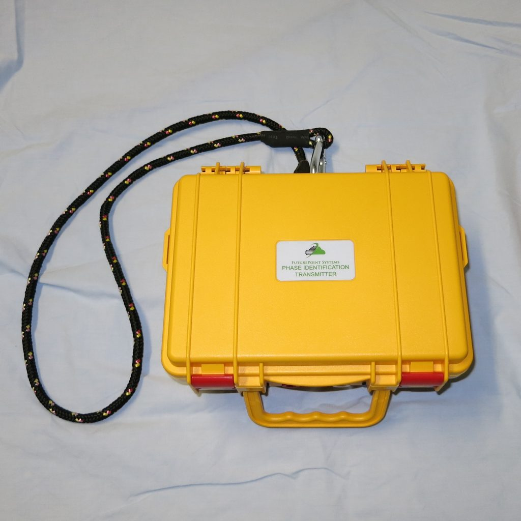 Picture of a closed case Phase I.D. Transmitter showing its hook and rope.